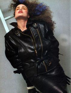 Michael Hoban/North Beach Leather, American Vogue, November 1984. Model: Andie McDowell.