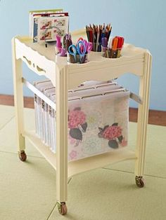Take an old table, cut some holes in the top for cups, paint, add some wheels….and you have a fabulous rolling craft station!  You could even roll it right into a closet when you're not using it!