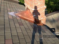 Custom copper cricket chimney installation with step flashing
