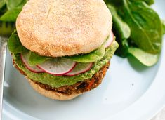 Lentil-chickpea veggie burgers with avocado green harissa and radish - cookieandkate.com