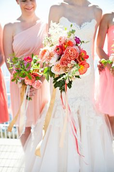 A coral-pink garden rose and poppy #bouquet | Brides.com