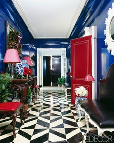 cobalt lacquered walls in black and white foyer. awesome