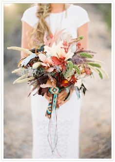 feather and floral southwestern inspired bouquet, by Jose Villa