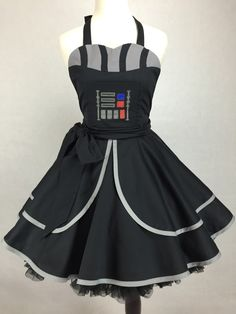 Any woman could take on an intergalactic scoundrel with this Boba Fett  pin-up style cosplay dress. It was created by Etsy seller ActionPink, and  it's the perfect outfit for any geek event. I've also included Darth Vader  andStormtrooper dresses she has made.If you're a geek girl whowould like  to get one for yourself, click here.