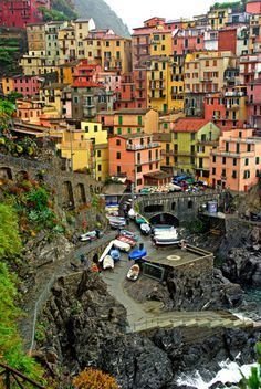 wow! so pretty...the rest is what someone that apparently knows said:    Manarola, Cinque Terre, Italy |    Cinque Terre: Five small fishing villages on the Italian Riviera coast turned to the world-class resort destination as UNESCO World Heritage Site; Monterosso, Vernazza, Corniglia, Manarola, and Riomaggiore.