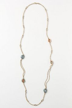 stitch seedbeads around larger pearls and crystals and put them on long chain for layered necklace