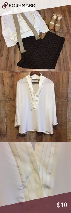 Vintage Cream Blouse - Stunning! This is a gorgeous vintage creamy white blouse from La Chine Plus by Galinda Wong. The blouse features a v-neck design with layered pleats on each side. It's a 3/4 sleeve. Each sleeve has two delicate buttons. This top is perfect for the office or a nice night on the town.  100% Polyester Machine Wash Warm Drip Dry Imported Size 16W  *See my other listings for the pants and heels! La Chine Plus by Galinda Wang Tops Blouses