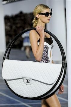 Wtf is this? Yes...let's make a hula hoop into a purse! No one would ever think to do that!......