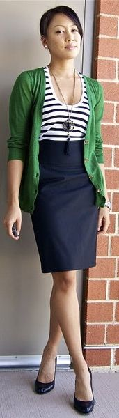 striped shirt, green cardigan, and navy skirt