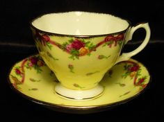 Royal Albert ~ Old Country Roses ~ Ruby Celebration Yellow Rosebud Tea cup/saucer
