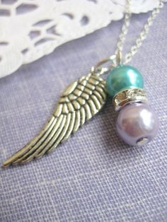 Miscarriage loss Angel wing glass pearl memorial.  Like the two beads together, the wing not so much.