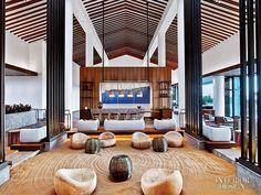 Walnut ceiling beams peak above the lobby of the Maui's Renaissance Wailea Beach Resort sand pit. #design #interiordesign #interiordesignmagazine