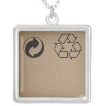 Sheet of cardboard with recycling logos custom jewelry
