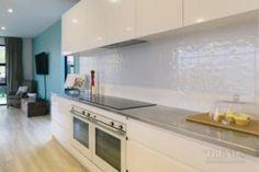 Crisp black and white kitchen designed by Apollo Bathroom & Kitchen