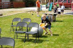 obstacle course- use big ball, board slide, chairs, hula hoop, tee ball stand, basketball hoop,