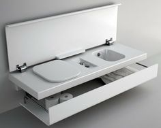 "One wall-mounted ""floating"" bench incorporates a washbasin or two and countertop, while the other features a ceramic toilet and bidet, topped by a lid that, when not in use, creates additional seating. Underneath, this bathroom line also includes a built-in storage shelf for towels, toiletries and tissues."