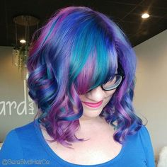 Y'all ever wondered what a nebula in outer space would look like if Lisa Frank had a say in it? I think it would look a little like this babe's new galaxy hair! ❤ Absolutely love this mix of Joico Intensity shades in Mermaid Blue, Pink and Indigo. . . . #ModernSalon  #AmericanSalon  #Balayage  #BalayageArtists #BalayagedAndPainted #MastersOfBalayage #Olaplex #WellaBlondor #Joico  #JoicoMermaidBlue #JoicoPink #JoicoIndigo #JoicoIntensity #UnicornTribe #PinkAndPurpleHair #GalaxyHair #Viv
