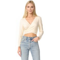 Jenni Kayne Wrap Tie Top ($110) ❤ liked on Polyvore featuring tops, ivory, ivory top, 3/4 sleeve tops, ballet wrap top, three quarter sleeve tops and 3 4 sleeve crop top