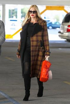 Gwen Stefani shows off her baby bump with a L.A.M.B plaid coat, sexy black dress, and knee high boots