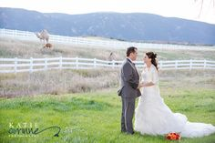 Camel in field in Colorado in back of bride and groom?  Yep!  This equestrian beautiful farm has a couple of different farm animals.  Southern Charm florist at Crooked Willow wedding.  Katie Corinne Photography