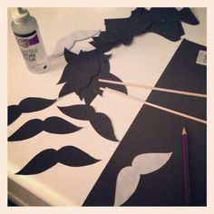 Making the Italian party mustaches.  Just use tape on a them, and take a picture of everybody wearing them