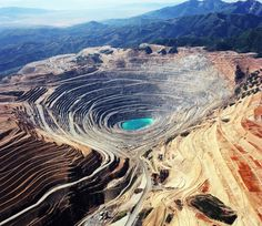 Utah - The Bingham Canyon Mine, more commonly known as Kennecott Copper Mine among locals, is an open-pit mining operation extracting a large porphyry copper deposit. It is southwest of Salt Lake City, in the Oquirrh Mountains. The mine is the largest man-made excavation in the world.