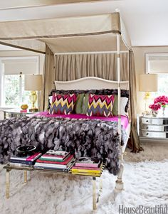Glamorous Bedroom by Martyn Lawrence Bullard. The canopied Jaipur bed was inspired by a bed that belonged to Babe Paley. His Adras Ikat Print pillows add a revved-up mix of the house's pink, blue, and yellow palette. | housebeautiful.com Photo by Tim Street-Porter