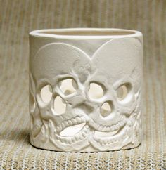 Ceramic Bisque Skull. I should try n make some like this.