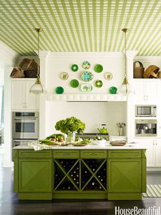 """Pea Green Kitchen: In a Purchase, New York, kitchen, designer Gideon Mendelson created a green gingham ceiling that was first painted on canvas by Silvère Boureau. Mendelson says, """"It gives a classic white kitchen personality, and it brings extremely high ceilings down to a more comfortable place."""" To further animate the room, Mendelson designed the island and painted it a custom bright green."""