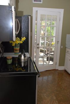 Kitchen Tour: Courtney and Andy's Cottage Galley. Like the french door to patio.