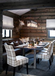 Modern rustic design, wood furnishings, plaid upholstered seating, wood wallcovering, pendant lighting- minus the taxidermy Chalet Design, Home Improvement Loans, Cabin Interiors, Hunting Lodge Interiors, Ski Lodge Decor, Cuisines Design, Cabin Homes, Rustic Design, Interior Design Living Room