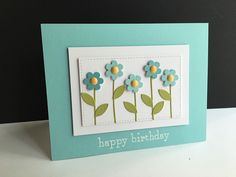 I made a birthday card for my daughter with some pretty little flowers, some glitter and in shades of aqua... I die cut and layere...