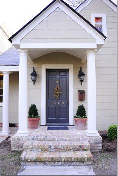 color scheme for the next house...white wash the brick and paint the cedar a lighter color, white trim, and dark gray/black door to match our gray roof.
