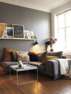 Love the set up, the shelf and the different crown molding. Grey couch and grey wall.