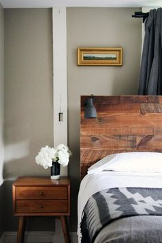 No space in the bedroom for a traditional table lamp, or just don't like the visual clutter? Clip a lamp directly on the headboard for light to read by at night.