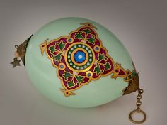 Rare and Unusual Antique Russian Porcelain Easter Egg, painted with Russian medieval style ornaments on a pale turquoise ground. Imperial Porcelain Factory, St. Petersburg, circa 1910.