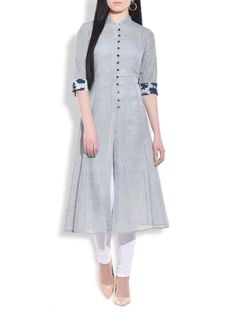 Be a fashionista by wearing this elegant stone blue flared long kurta available exclusively on Limeroad. Crafted using finest quality jute, this front cut kurta comes with wooden buttoned closure for perfect fit. Designed to perfection, it comes with a unique bagroo print on cuffs. Team it up with a pair of black pencil heels and you are ready to be the charm of any outing.
