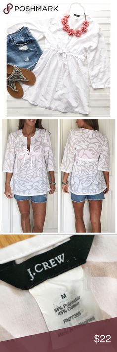 "J. Crew Embossed Beach Tunic . J. Crew Embossed Beach Tunic | size M; poly/cotton . Empire waist tunic with deep v at neck at adjustable drawstring under bust | 3/4 length bell sleeves | white-on-white embossed pattern - slightly sheer | perfect as a beach cover up! . EUC, no flaws, smoke-free home . 20"" UA to UA 29.5"" length J. Crew Tops"