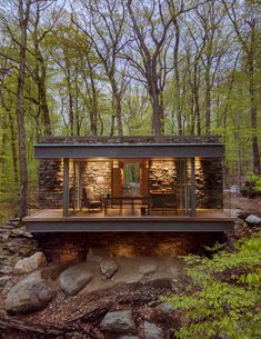 "American architect Eric J Smith has used stone, oak and glass in this poet's writing studio, to ""reinforce its sense of belonging"" in the Connecticut woods. Writing Studio, Historic New England, Casas Containers, Wooden Staircases, Tiny House Movement, House Extensions, Residential Architecture, Architecture Logo, Architecture Drawings"