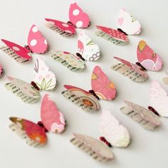 Scrapbook butterflies with newspaper underneath