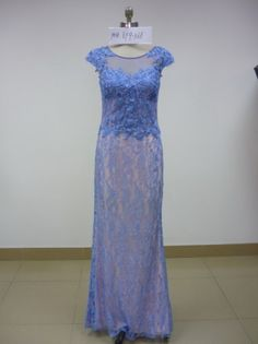 Blue cap sleeve mother of the groom dress made with beaded lace and a sheer illusion neckline. Longer sleeves can easily be added to the design of this formal evening gown. We have many other mother of the groom evening dresses at http://www.dariuscordell.com/featured_item/custom-made-mother-of-the-bride-evening-dresses/