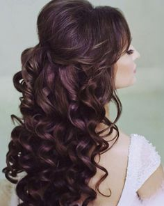 Curled and teased bridal hair
