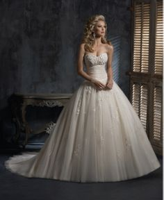I know that Timmy would love this <3   Maggie Sottero Bridal  Style Number:Chardonnay - S5261    $988.00