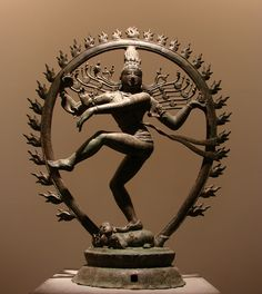"Created in south India sometime in the 9th or 10th century, the Shiva Nataraja, as it is known, depicts ""the dancer whose dance is the universe,"" in the words of the great mythologist Joseph Campbell. Shiva's four arms represent his infinite reach over all four cardinal points. His right foot stands on a slain demon, symbolizing the destruction of ignorance; the left leg is raised, bent at the knee and turned in perfectly balanced torque, as if the god were frozen in mid-whirl with his long…"