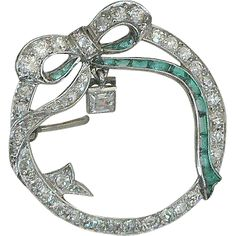 Platinum Diamond Emerald Circle Bow Pin from Jamie's Antiques at RubyLane.com