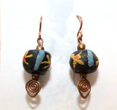 Unique earrings made from Krobo beads. Artisans in Ghana create these beads from recycled glass (bottles, jars) and paint them by hand. Each bead and earring pair is unique. All proceeds go to the SDA School in Ankaase, Ghana to help build a computer lab. $10. www.armsaroundankaase.storenvy.com