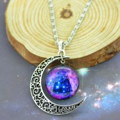 Nebula Moon Pendant | Sterling silver crescent moon with hanging round pendant showing the amazing colors of the nebulous galaxy.