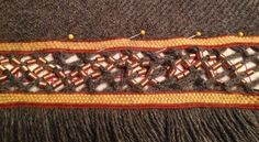 Border with interlaced fingerloop braiding with coils, horribly distorted and wrong.  So very wrong.