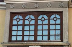 historical window with frescoes and arcs at the top