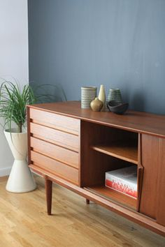 Via Midcentury Modern Finds | Credenza with a grey wall